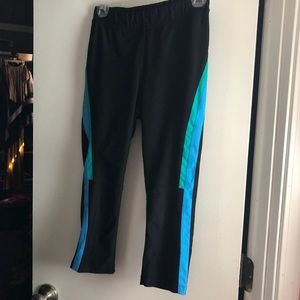 Black, blue, and green active leggings